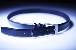 TIGHTENING THEIR BELTS :  Whether due to more reporting or actual increases in the disease, experts are diagnosing more eating disorders in men. - PHOTO ILLUSTRATION BY STEVE E. MILLER