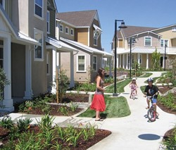 A HOME OF THEIR OWN :  San Luis Obispo's inclusionary housing ordinance allowed the Douglas family Jaclyn, 26 Walker, 5 Spencer, 6 and (not pictured) Jeremy, 29 to buy a three-bedroom home in mid-August in a new Centex development on Broad Street. - PHOTO BY KATHY JOHNSTON