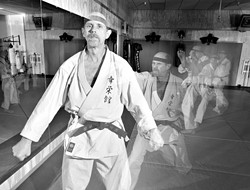 CAN DO :  Koei-Kan Karate-Do owner and instructor Larry Rhodes is celebrating his martial arts dojo's 15th anniversary with plenty of kick. - PHOTO BY STEVE E. MILLER