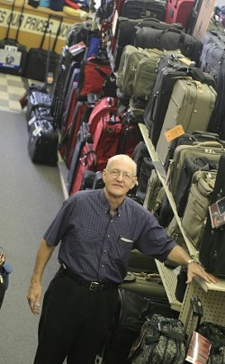 CARRYOVER BUSINESS :  Bob Douglass, owner of San Luis Luggage, purchased a Rasco's Five and Dime store in 1971, which has since evolved into a specialty luggage store. - PHOTO BY CHRISTOPHER GARDNER