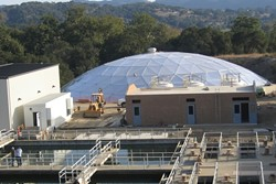 WATERTIGHT :  A new dome covers water that is ready to flow from the Lopez facility into local homes. - PHOTO BY KATHY JOHNSTON