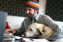 A BOY AND HIS DOG :  Todd Peterson and dog Soda Pop head Red Canary Productions, a company that specializes in bringing unique, broadcast-quality media to the web. - PHOTO BY CHRISTOPHER GARDNER