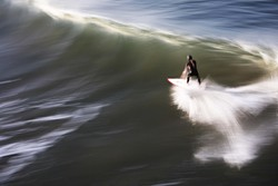 An unidentified surfer gets some just south of the Pismo Beach pier - PHOTO BY STEVE E. MILLER