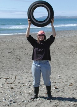 TONS OF TRASH :  Kathi DiPeri reveals the sort of trash found at Cayucos Beach. Cleaning up local beaches is a popular annual event for around 1,500 volunteers, with Sept. 15 set for this year's Coastal Cleanup Day. - PHOTO COURTESY OF/COPYRIGHT GAIA GRAPHICS & ASSOCIATES