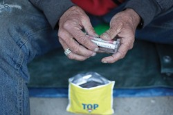Rollies--cigarettes--are a common fixture among the homeless, with both Mike and Brad touting the appetite suppressant properties of smoking as the primary reason why they smoke. - PHOTO BY STEVE E. MILLER