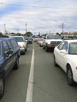 TIRED OF WAITING :  Traffic piles up daily on Nipomos West Tefft Street, as commuters wait to enter Highway 101, but congestion may clear if the San Luis Obispo County Board of Supervisors approves the neighborhoods new design plan. - PHOTO BY JEANINE STEWART