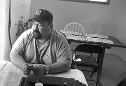MAKING IT ADD UP :  Jesse does the books for Sunny Acres and is one of the few residents who is going to be allowed to stay. - CHRISTOPHER GARDNER