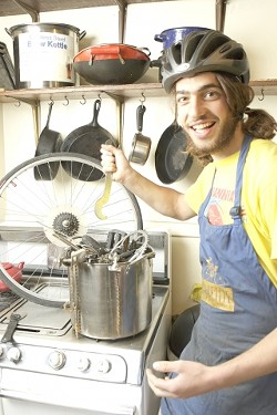 """WHAT'S COOKING?:  Brant Haflich, one of four """"sous chefs"""" for the SLO Bike Kitchen, is cooking up some fun with parts. - PHOTO BY STEVE E. MILLER"""