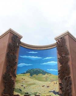 """VERISIMILITUDE:  When the Marsh Street Parking Garage blotted out the view of Cerro San Luis from the corner of Morro and Pacific streets, artists Carol Paulson and Stephen Plowman decided to create """"Magic Sister,� a mural that recreates the view in paint. - GLEN STARKEY"""