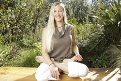 SITTING LOTUS :  Amy Swanson, owner of The Yoga Centre, entered into a lease agreement with Michael Brevetz, to share space at Tridosha. When Tridosha collapsed, she was left without a studio--or a refund for her rent and deposit. - PHOTO BY STEVE E. MILLER
