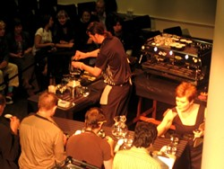 COFFEE IS CULINARY :  Chris Bord of Linnaea's Cafe competed in the Western Regional Barista Competition in late March, with a handful of judges watching his every pour.