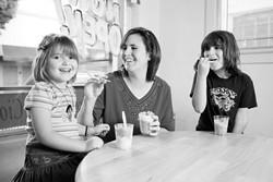 ALL SMILES :  Jo Ann (center), Brianna (right), and Brittany (left) enjoy tasty treats at G's Italian Freeze. - PHOTO BY STEVE E. MILLER