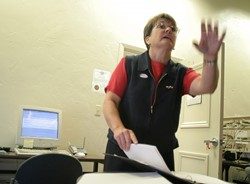 MAKING IT HAPPEN :  While the county's clerk-recorder, Julie Rodewald, could have been the most stressed person in the county on election night, she calmly traveled between her office and the county courthouse, announcing new developments as poll workers collected and counted votes. - CHRISTOPHER GARDNER