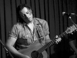 COWBOY LOGIC :  Countrified Austin-based singer-songwriter Eric Hisaw plays the Clubhouse on Feb. 12. - PHOTO COURTESY OF ERIC HISAW