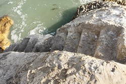 STAIRWAY TO NOWHERE :  This stairway, carved out of the rock, is one reminder of a bygone era at the beach. Some people believe it was built by Sir Francis Drake--and may be a clue to finding his fabled treasure--but more likely it was built by rogue traders during the mid 19th century. - PHOTO BY STEVE E. MILLER