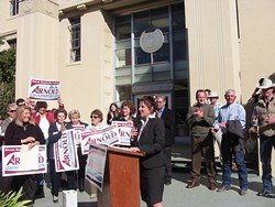 ARNOLD ANNOUNCES :  Flanked by supporters, Debbie Arnold announced her plans to run for the 5th District supervisor seat at a Jan. 11 rally on the steps of SLO's Old Courthouse. - PHOTO BY PATRICK HOWE