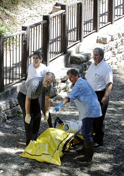 ON THE SCENE:  Investigators remove Sharon Ostmans body from SLO creek on July 11. - PHIL KLEIN