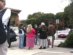TWO GROUPS :  Demonstrators regularly gather outside of San Luis Obispos Planned Parenthood office, which prompts volunteers (such as the one in the black vest at left) to escort women seeking abortions in and out of the building. - PHOTO CONTRIBUTED
