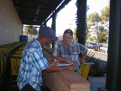 PLEASE SIGN HERE :  San Luis Obispo resident Terry Mohan (right) is fighting water rate hikes the old-fashioned way, with an initiative petition. Walter Shipp (left) said he signed it to protest higher water bills. - PHOTO BY KATHY JOHNSTON