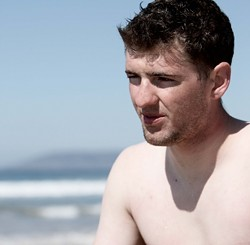 Lance Cpl. Travis Dodson reflects on his first-ever surf session. - PHOTO BY STEVE E. MILLER