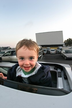 """MAKING MEMORIES:  Young Owen, Amy and Garth Turners almost-2-year-old son, had been to the drive-in before, but this would probably be """"the first time he will remember it,"""" said Garth. - CHRISTOPHER GARDNER"""