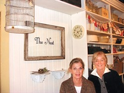 """COLLECTORS :  Pam McKiernan (left) and Judy Mora (right) opened their retro houseware and gift shop The Nest in the historic Ah Louis building. Their specialty is """"repurposing"""" vintage items into modern de cor. - PHOTO BY KYLIE MENDONCA"""