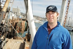 CONSERVING THE RESOURCES :  Michael Bell of The Nature Conservancy is working with local fishermen on a new model for managing and harvesting local fish in a sustainable way for the environment, the community, and the fishing industry. - PHOTO BY STEVE E. MILLER
