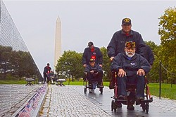 NUMBERED DAYS:  The Honor Flight organization is working hard to get as many World War II vets, who are passing away at the alarming rate of 600 a day, to visit and reflect at the memorial dedicated to when they served. - PHOTOS COURTESY OF SUPER IMAGE LTD