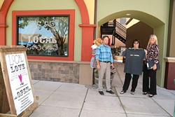 LOVE LOCAL:  Wendy Estus (center), with Love Local Boutique, asks Community Development Director Phil Dunsmore (left) and Deputy City Manager Terrie Banish (right) if the North County Farmers Market will return to downtown. - PHOTO BY DYLAN HONEA-BAUMANN