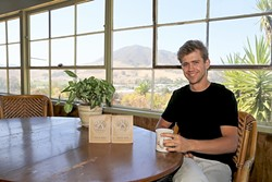 SPECIALTY SIP:  Backdropped by SLO's iconic hills, Paradigm Coffee Co-Founder and Roastmaster Reid Patterson takes a time out from roasting for a hot cup of speciality goodness. - PHOTO BY DYLAN HONEA-BAUMANN