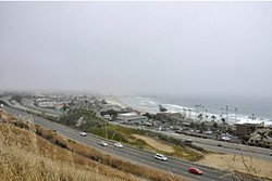 PEEK-A-BOO:  The hotels along the coast are barely visible through the fog. - PHOTO BY CAMILLIA LANHAM