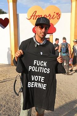 TRANSFORMATIONAL POLITICS:  Lightning in a Bottle co-founder Dede Flemming holds up a shirt supporting Bernie Sanders. - PHOTO BY DYLAN HONEA-BAUMANN