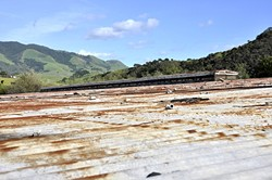 FUTURE WATER:  SLO city biologist Freddy Otte has plans to turn the roof of this old reservoir off Fox Hollow Road into a cistern to help augment the flow of water in San Luis Obispo Creek. - PHOTO BY CAMILLIA LANHAM