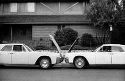 A CRASH OF SORTS:  Local artist Erik Olson was inspired by the symmetry between two cars and the design of a house, which resulted in the photograph 'Two Lincolns One Guy.' - PHOTO COURTESEY OF ERIK OLSON