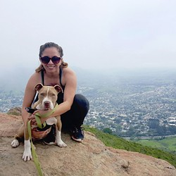 STARTED FROM THE BOTTOM, NOW WE'RE HERE:  After being put in puppy leg casts to heal his front legs that were bent due to malnourishment, Hercules the puppy is now hiking Madonna Mountain like a champ. - PHOTO COURTESY OF RYAH COOLEY