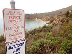 KEEP OUT:  The California Coastal Commission sent a stern letter of warning to the city of Pismo Beach over these signs, which they say could discourage public access to the bluffs and trails near Pirate's Cove. - PHOTO BY CHRIS MCGUINNESS