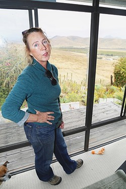 SICK TO HER STOMACH :  Morro Bay resident Jacqueline Marie overlooks the Righetti Ranch from her bedroom window. She lives on Nutmeg Avenue, and that view could change if the city builds a wastewater treatment facility on the ranch. - PHOTO BY DYLAN HONEA-BAUMANN