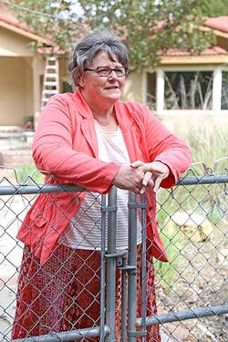 UNCONVINCED:  Sue Harvey explains her concerns with the proposed water district. - PHOTO BY DYLAN HONEA-BAUMANN