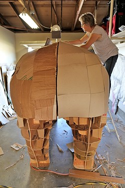 BIG, BEAUTIFUL RHINOCEROS :  Abby Belknap, an artist in the Central Coast Sculptors Group, works on the sizeable rear end of the rhinoceros. - PHOTO BY DYLAN HONEA-BAUMANN