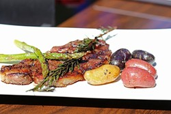 STEAK AT A SUSHI JOINT?:  This rosemary rubbed steak plated with fingerling taters and fresh asparagus offers up a meaty counterpoint to a menu chock-full of light sushi and sashimi. - PHOTO BY DYLAN HONEA-BAUMANN