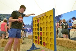 IT'S GO TIME:  Of course, there's more to do than just drink beer—you could drink beer and challenge fellow drinkers to a giant game of Connect Four, like this guy did. - PHOTO BY DAVID MINSKY