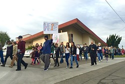 MESSAGE OF HOPE:  Several prayer walks have occurred in Santa Maria following the increase in gang violence, including one led by the Santa Maria Foursquare Church on Jan. 17 (pictured), and another led by Victory Outreach on Jan. 30. - PHOTO COURTESY OF TIM MOSSHOLDER