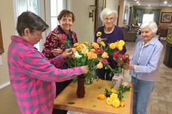 BRIGHTENING DAYS:  Nora, Elayne, Ruth and Phyllis (left to right), residents at Oakpark Manor in Arroyo Grande, joyfully arrange the flowers delivered to them by Flower Power. - PHOTO COURTESY OF STEVE BENNETT