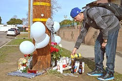 IN MEMORIAM:  Matt James, 24, pays his respects to Javier Murillo-Sanchez and Aaron Sanchez-Hernandez, 23-year-old cousins killed in Santa Maria on their way home from an Alcoholics Anonymous meeting on Jan. 13. - PHOTO BY DAVID MINSKY