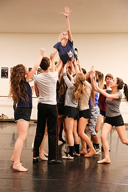 IF YOU LOSE, THE DEVIL GETS YOUR SOUL:  A group of dancers lifts up a young Betty Parris (Madison Price), whose soul is being tortured by the devil, during a rehearsal for the Civic Ballet's production of The Crucible. - PHOTO BY DYLAN HONEA-BAUMANN