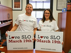 VOLUNTEERS WANTED:  Chris Blake and Stephanie Buresh took the lead on bringing Love SLO to San Luis Obispo. On March 19, hundreds will participate in a day of volunteering throughout the community. - PHOTO BY DYLAN HONEA-BAUMANN