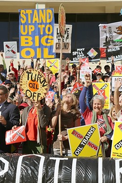 ENTRENCHED OPPOSITION:  Protesters rally against oil trains at a SLO County Planning Commission hearing on the Phillips 66 rail spur project earlier this year, and they still haven't changed their minds. - FILE PHOTO BY DYLAN HONEA-BAUMANN