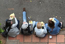 STREET GRUBBIN':  The curb is as good a place as any to dine during Downtown SLO Farmers' Market. - PHOTO BY DYLAN HONEA-BAUMANN
