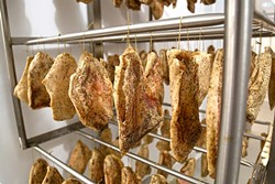 HANG ON:  Dozens of handmade guanciale (cured pork jowl) age to a graceful flavor. - PHOTO BY DYLAN HONEA-BAUMANN