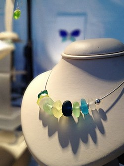 STUNNING :  Sea glass, treasured by local collectors and artists, is the star of an upcoming Cayucos festival. Recent rumors suggest that the demand may have prompted a few aficionados to start dumping broken glass into the ocean with the goal of making more. - FILE PHOTO